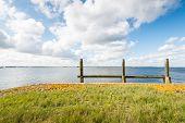 Wooden Moorings In A Broad Estuary