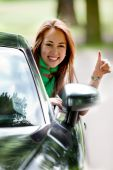 Woman In A Car With Thumbs Up