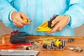Hands service engineer of electronic equipment in service workshop