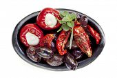 Dish of antipasto, isolated on white. Black olives, sundried tomatoes, and mozzarella stuffed bell p
