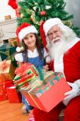picture of santa-claus  - Christmas portrait of a girl with Santa Claus smiling - JPG