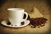 stock photo of mug shot  - a brown  coffee mug and coffee beans - JPG