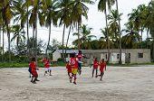 ZANZIBAR, TANZANIA - MARCH 26 2013: local african soccer team during training on sand playing field
