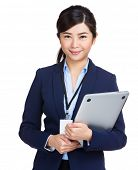 Businesswoman holding laptop computer