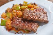 Adana kofte with roasted vegetables