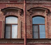 Two Windows And Drainpipe, On Red Brick Wall poster