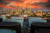 stock photo of chimney  - Landscape of oil refinery industry with oil storage tank and pulution environment - JPG