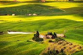 Pienza, Rural Sunset Landscape. Countryside Farm And Green Field. Tuscany, Italy.