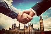Business in London. Handshake on Big Ben, Westminster background. Deal, success, contract, cooperation concepts