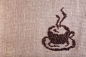Coffee Cup Made Of Beans On Burlap Background