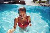 Young Lady Enjoying Herself In Swimming Pool