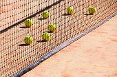 Tennis Balls On The Court Near Tennis Nets