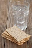 Wheat Crispbread Slices And Glass Of Water