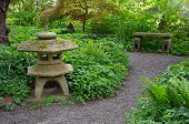 foto of garden sculpture  - Green serene japanese garden with memorial and bench - JPG