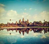 Vintage retro effect filtered hipster style travel image of Cambodia landmark Angkor Wat with reflec