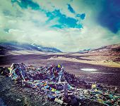Vintage retro effect filtered hipster style travel image of Buddhist prayer flags (lungta) on Barala