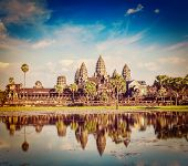 Vintage retro effect filtered hipster style travel image of Cambodia landmark Angkor Wat with reflection in water