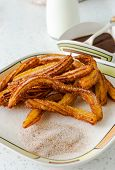 picture of churros  - Typical Spanish fried pastry for dessert  - JPG