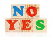 NO YES words formed by wood alphabet blocks, isolated on white background