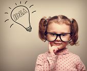 Cute Thinking Kid Girl In Glasses With Idea Bulb Looking