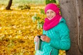 Cute girl with autumn leaves