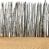 picture of log fence  - Old Wooden Fence on the Sand Isolated on the White Background - JPG