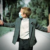 Kid In The Flu Mask