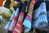 stock photo of handicrafts  - Handicraft skirts colorful costume tribal northern in Thailand - JPG