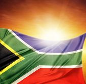 South African flag in front of bright sky