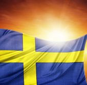 Swedish flag in front of bright sky
