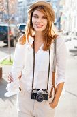 Travel tourist woman with camera and baguette