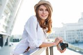 Travel tourist woman with camera