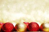 Heap of Christmas balls on golden background