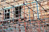 Scaffolding Around Brick Facade