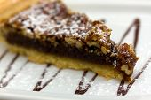 Southern chocolate chip walnut-pecan pie isolated over white. Shallow DOF
