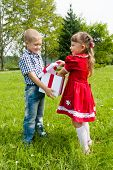 happy kids with gift in park