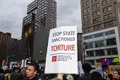 Stop State Sanctioned Torture sign