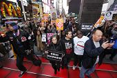 Marchers climb red steps in Times Square