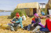 Tourists visiting one of Uros islands at Lake Titicaca, Peru