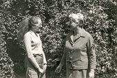 Vintage photo of mother and daughter outdoor, sixties
