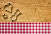 Wooden background with cookie cutters