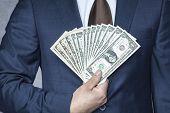Happy Businessman With Large Cash