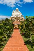 VUNG TAU, VIETNAM - JANUARY  2014: Buddha statue at top of a hill