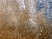 Close up of rusty metal surface in browns and blue