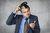 Businessman With A Funny Haircut Can Not Handle Phone