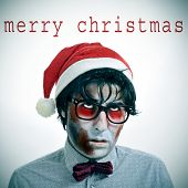 the sentence merry christmas and a hipster zombie wearing a bow tie and glasses and a santa claus hat