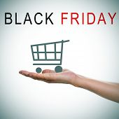 the text black friday and a man hand holding a shopping cart