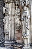 Three religious statues on a church wall