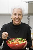 Senior Woman Eating A Healthy Salad