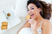 Beautiful Young Woman Having Breakfast On Bed.